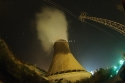 Cooling tower of a charcoal power plant at night, Spain